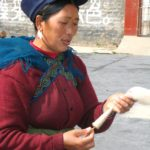 Nosu woman with bobin