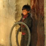rurlal Chinese boy, boy with tire