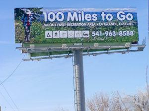 Meg and billboard at Ontario Oregon