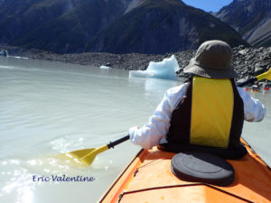 Meg paddling toward iceberg