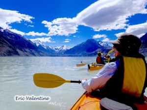 Meg paddling into the sky on Tasman Lake