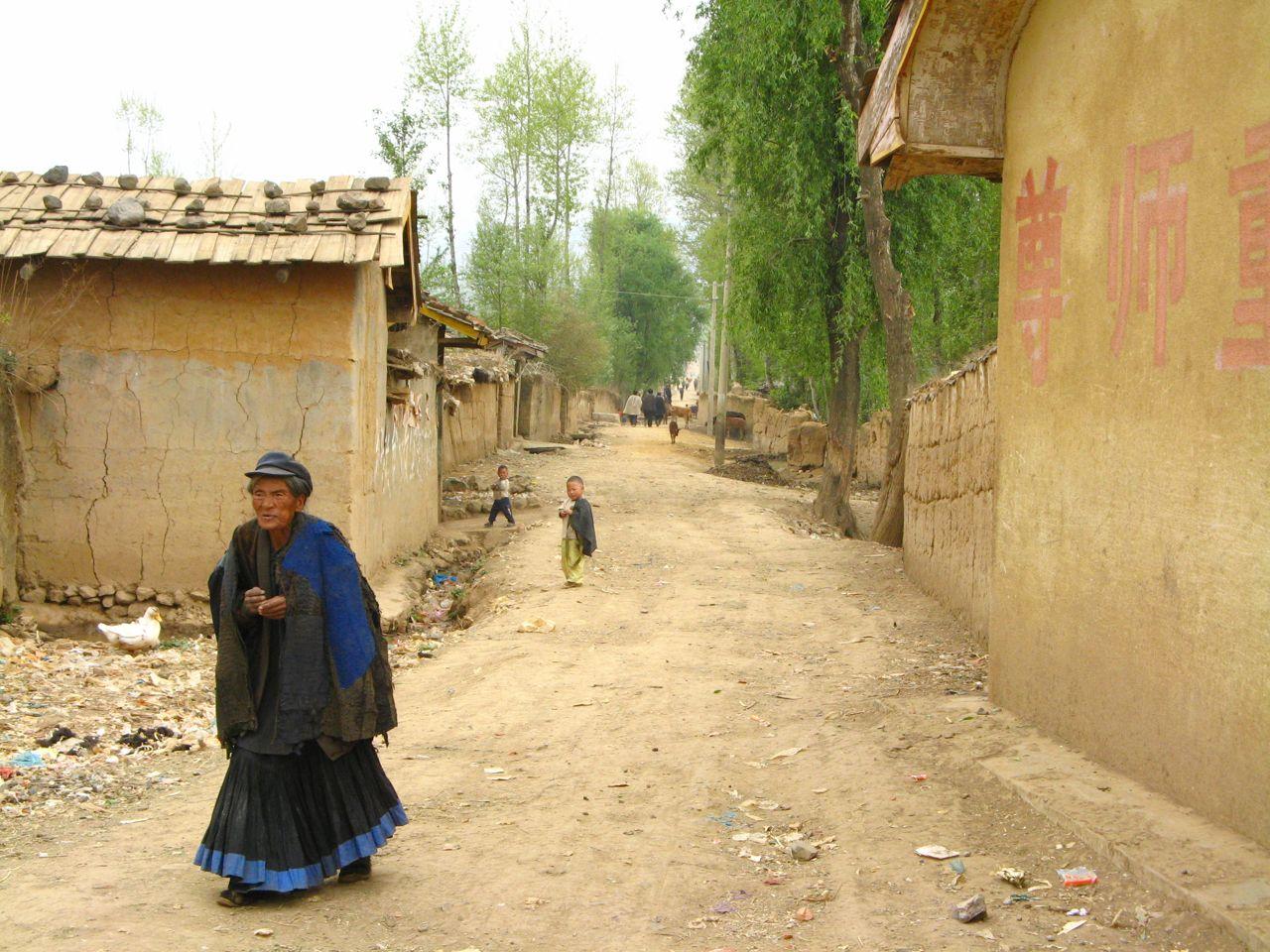 Nosu woman mud houses rural china