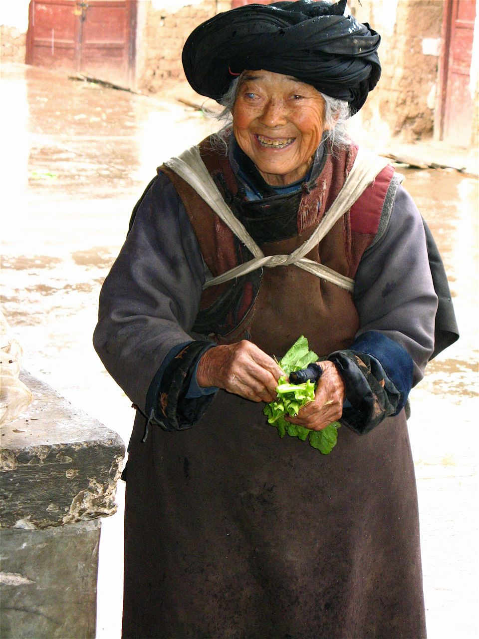 Elderly nosu woman vegetable seller