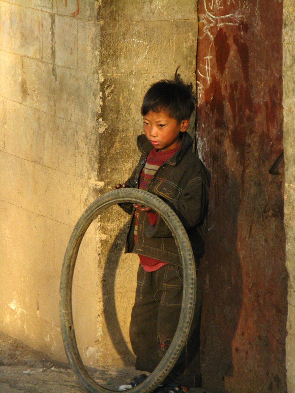 Rurlal chinese boy boy with tire